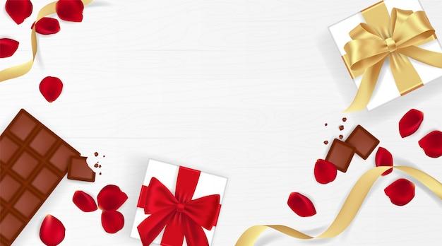 Feliz día de san valentín fondo con pétalos de rosa, chocolate y caja de regalo
