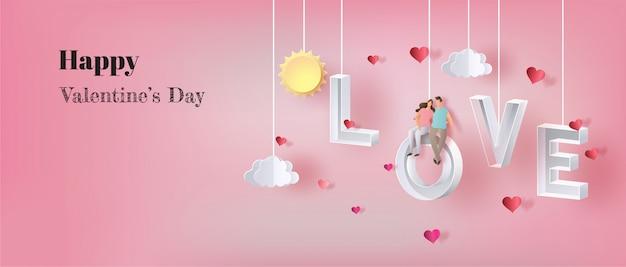 Feliz día de san valentín, pareja de enamorados sentados en la letra amor.