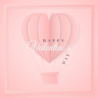 Feliz día de san valentín plantilla de tarjeta de invitación retro con globo de aire caliente de papel de origami en forma de corazón. fondo rosa.