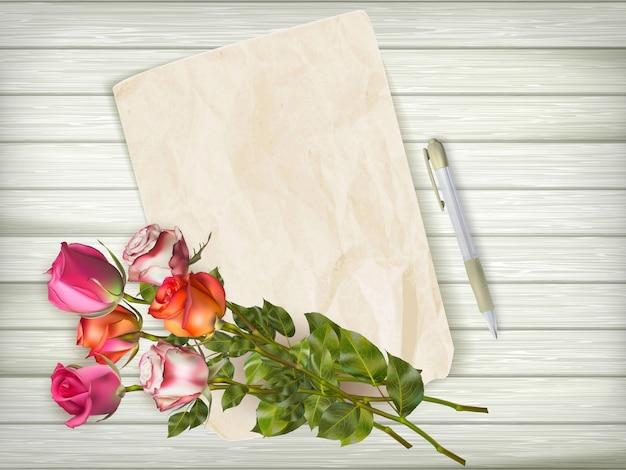 Feliz día de san valentín tarjeta de vacaciones con papel y flores sobre fondo de madera. archivo incluido