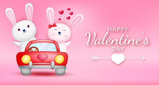 Feliz día de san valentín texto de saludo con pareja de conejo conduciendo un coche