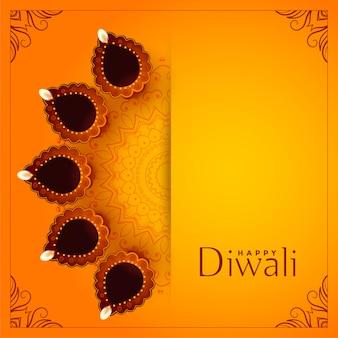 Feliz diwali fondo amarillo con diya decorativa