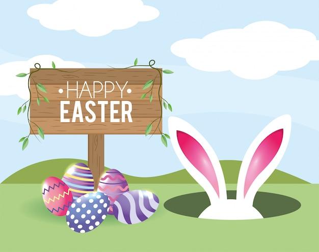 Feliz emblema de madera de pascua con conejo de pascua y decoración de huevos