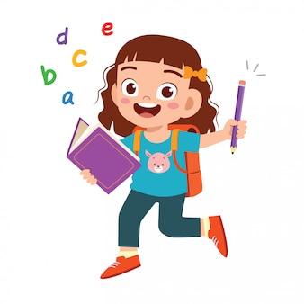 Feliz estudiante lindo niño niña con libro y lápiz