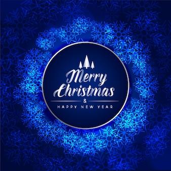 Feliz festival de navidad tarjeta azul hecha con copos de nieve