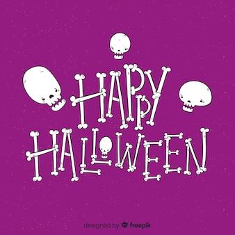 Feliz fondo de letras de halloween con calaveras