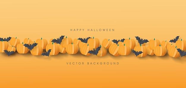 Feliz halloween con calabazas y fondo de murciélagos de papel.
