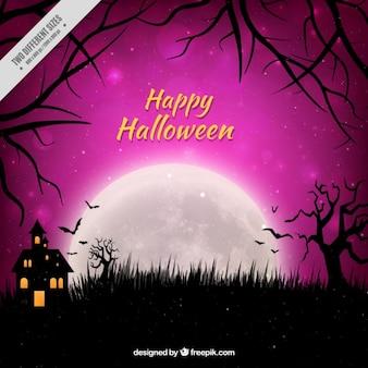 Feliz halloween con el cielo púrpura y una casa encantada