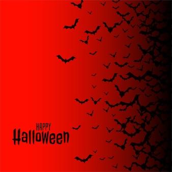 Feliz halloween rojo con murciélagos voladores