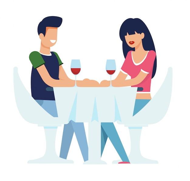 Feliz hombre y mujer hablando durante la cena romántica