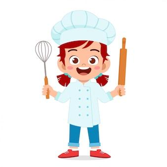 Feliz linda chica en traje de chef