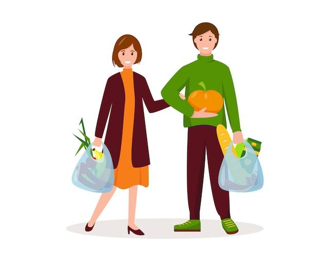 Feliz mujer y hombre con bolsas con comida. concepto de compras.