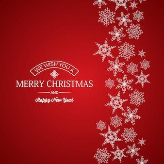 Feliz navidad y año nuevo tarjeta saludo inscripción y copos de nieve de diferentes formas en rojo