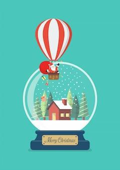 Feliz navidad bola de cristal con santa en globo y casa de invierno