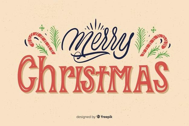 Feliz navidad caligrafía y bastones de piruleta