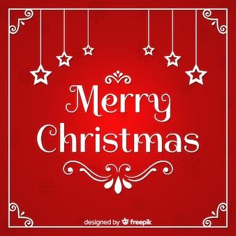 Feliz navidad caligrafía con estrellas sobre fondo rojo.
