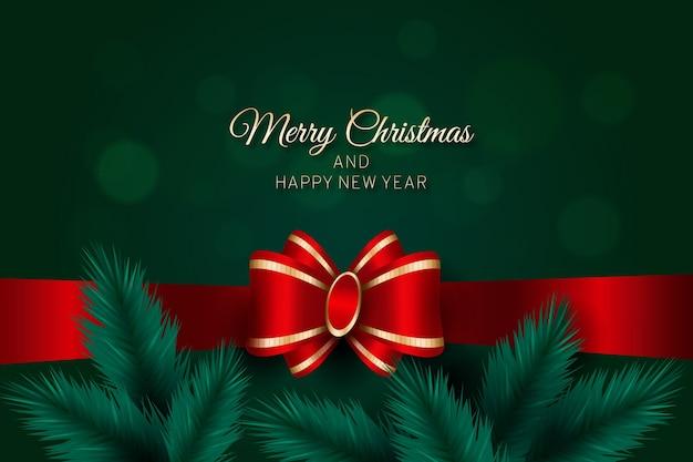 Feliz navidad con cinta y hojas de pino