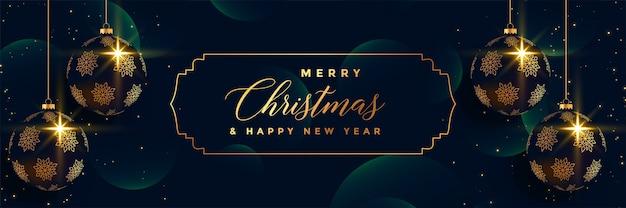 Feliz navidad colgando bolas 3d premium banner design