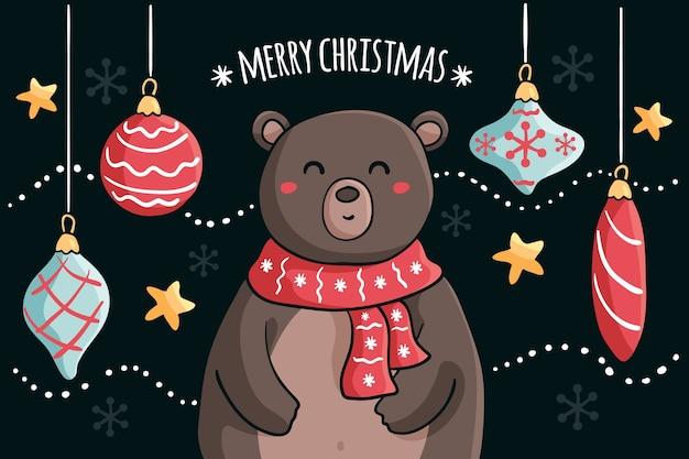 Feliz navidad con coloridas bolas navideñas y osito de peluche