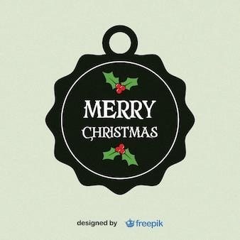Feliz navidad, etiqueta circular con hojas de acebo en la parte inferior y superior