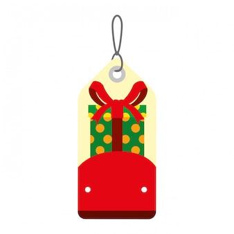 Feliz navidad etiqueta colgando con regalo