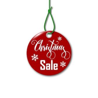 Feliz navidad. etiqueta de venta de navidad en la cuerda.