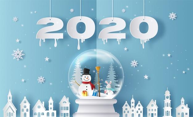 Feliz navidad y feliz año nuevo 2020 con bola de nieve y pueblo, tarjeta de felicitación e invitación.