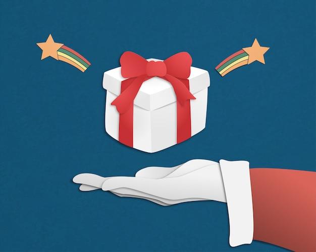 Feliz navidad y feliz año nuevo con caja de regalo santa claus mano sobre fondo azul en papel cortado estilo.