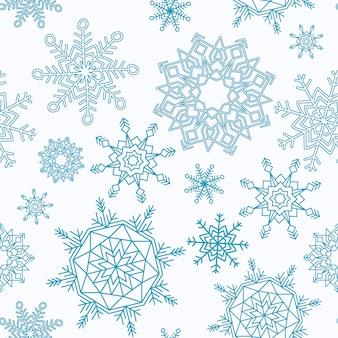 Feliz navidad y feliz año nuevo patrón transparente con copos de nieve.