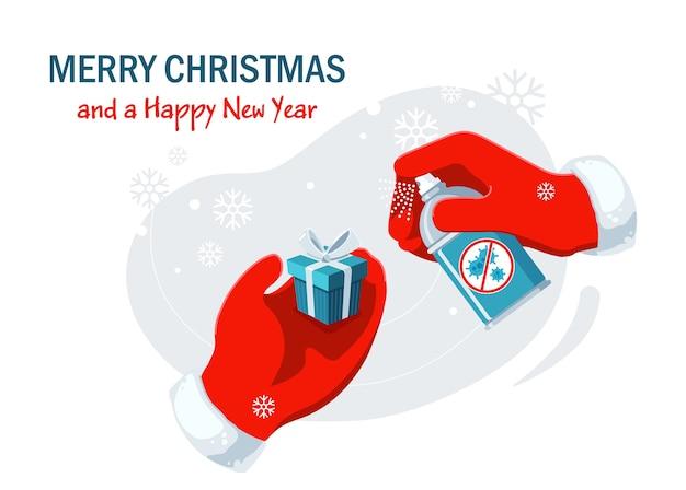 Feliz navidad y feliz año nuevo plantilla de banner de vector horizontal con las manos de santa en guantes rojos, sosteniendo el presente y desinfectante.