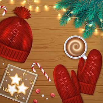 Feliz navidad feliz año nuevo saludo fondo ramas de abeto, sombrero rojo, guantes, café, galletas