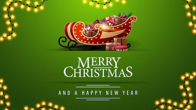 Feliz navidad y feliz año nuevo, tarjeta de felicitación verde con guirnalda y trineo de santa con regalos