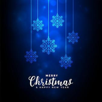 Feliz navidad fondo azul con decoración de copos de nieve