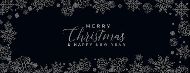 Feliz navidad fondo negro con borde de copos de nieve