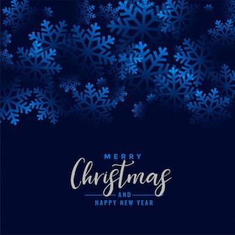 Feliz navidad hermosos copos de nieve azul