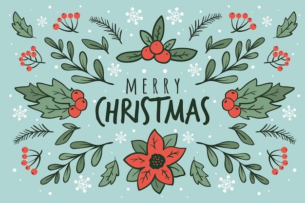 Feliz navidad con hojas de pino y muérdago