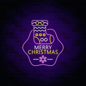 Feliz navidad letrero de neón con icono de calcetín de navidad