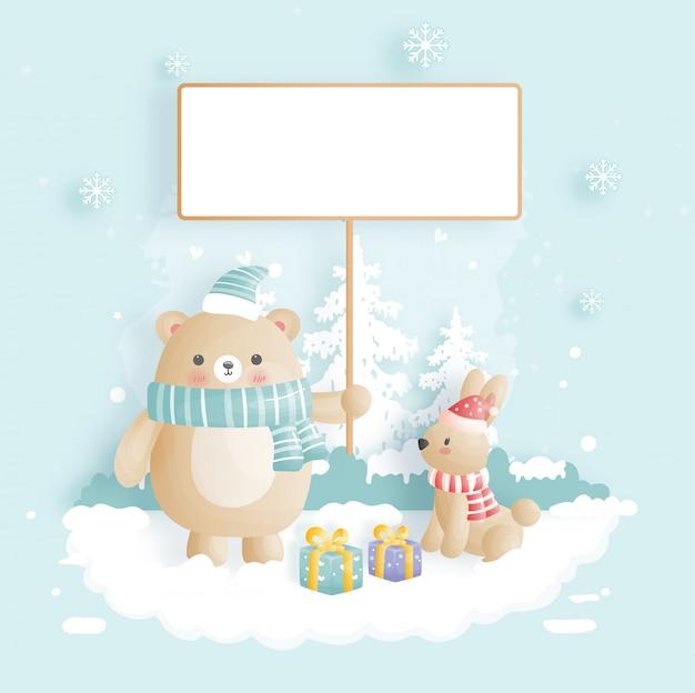 Feliz navidad con lindo oso con un cartel en blanco con conejo.