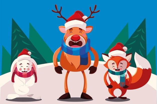 Feliz navidad lindo zorro reno y conejo con bufanda en la ilustración de la escena de nieve