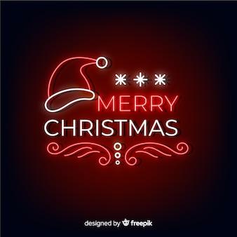 Feliz navidad de neón con gorro de santa