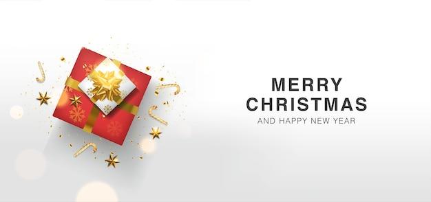 Feliz navidad y próspero año nuevo fondo con caja de regalos realista tarjeta de felicitación en la vista superior