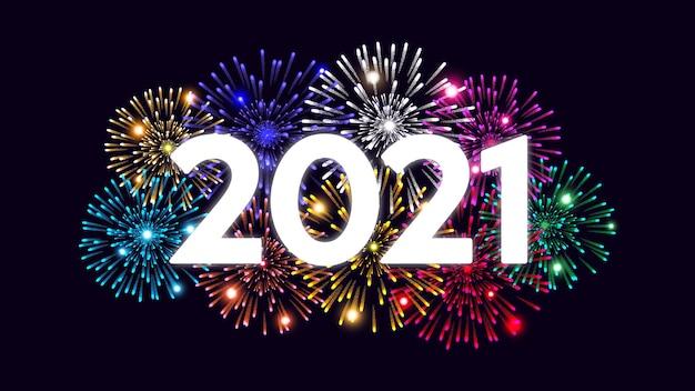 Feliz navidad y próspero año nuevo sobre fondo oscuro con fuegos artificiales.