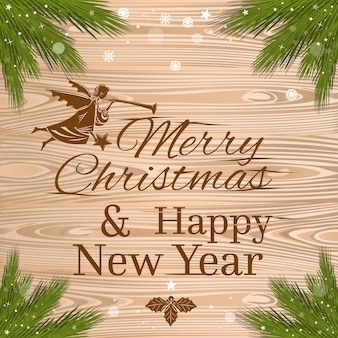 Feliz navidad y próspero año nuevo. tarjeta de felicitación de feliz navidad con ángel de navidad y ramas de abeto sobre un fondo de madera.