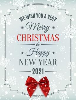 Feliz navidad y próspero año nuevo texto tipográfico sobre fondo de invierno con lazo rojo, nieve y copos de nieve.