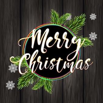 Feliz navidad y ramas de abeto sobre un fondo de madera.