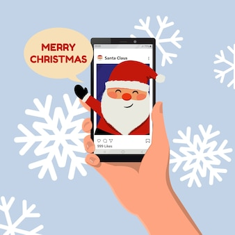 Feliz navidad saludo de las redes sociales. lindo santa claus sonriendo. mano sosteniendo un teléfono inteligente. vector de dibujos animados de estilo plano.