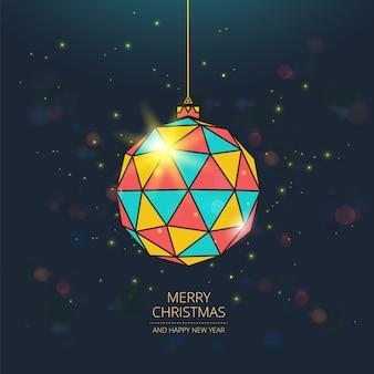 Feliz navidad tarjeta de felicitación. bola de navidad de color con partículas brillantes.