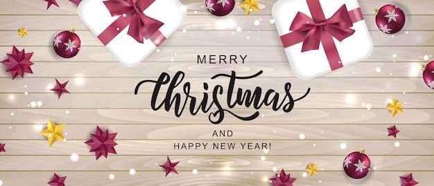 Feliz navidad tarjeta de texto de letras a mano. inscripción de tipografía para el diseño de vacaciones de año nuevo y navidad con elementos festivos.
