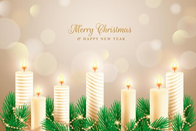 Feliz navidad texto con fondo de pantalla de velas