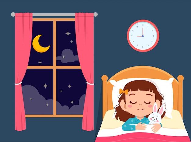 Feliz niña linda dormir en la habitación de la cama